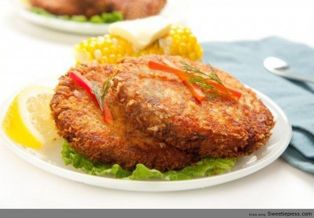 7860610-large-dinner-sized-salmon-croquettes-served-with-corn-1024x713 ...